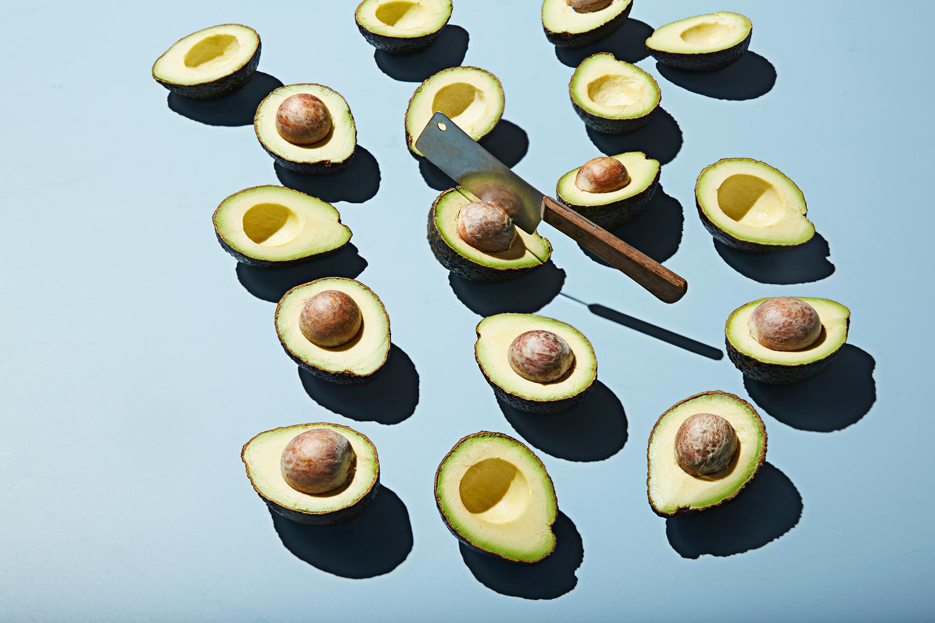 Many Avocados with Cleaver