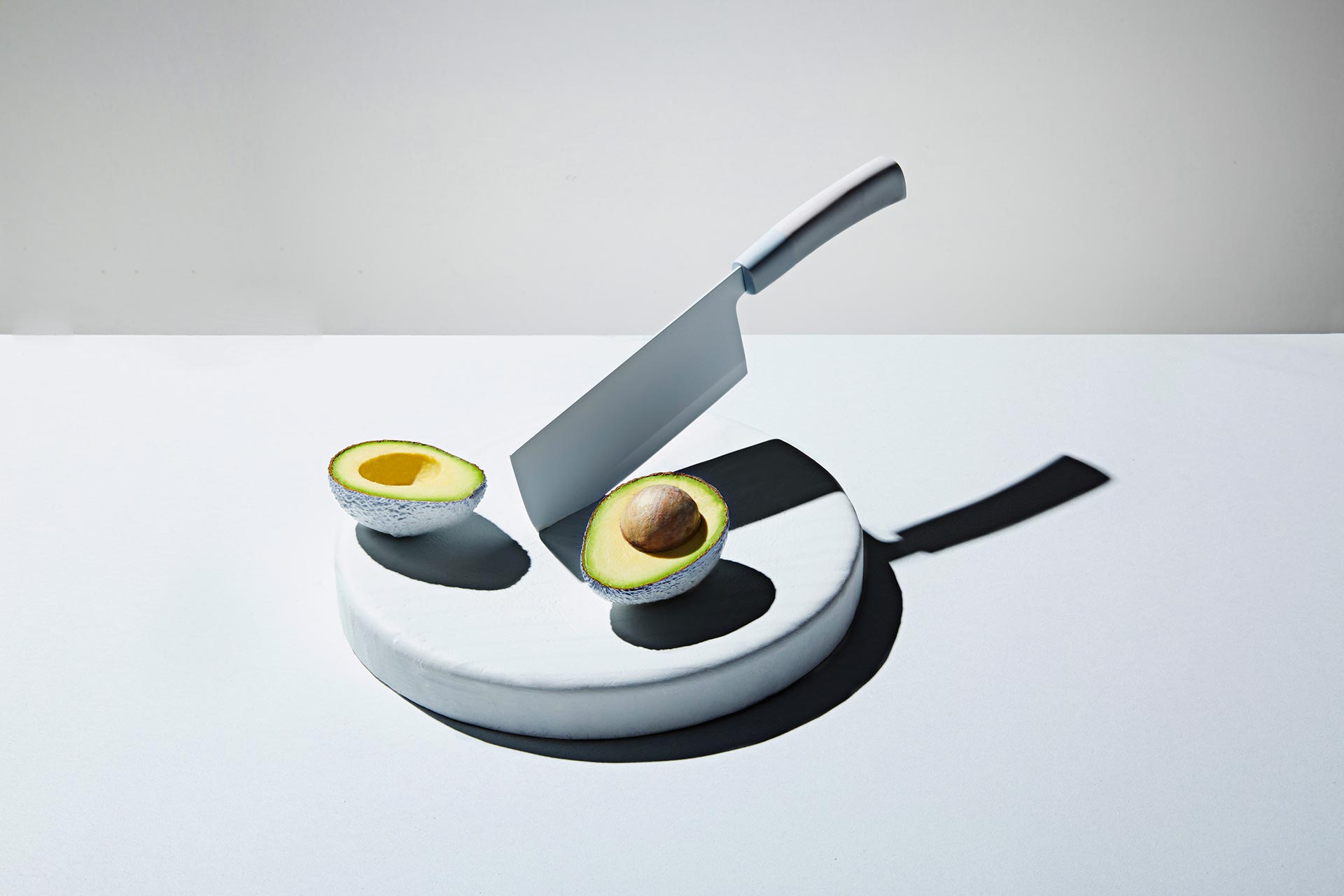 Avocado and Cleaver on a Chopping Block