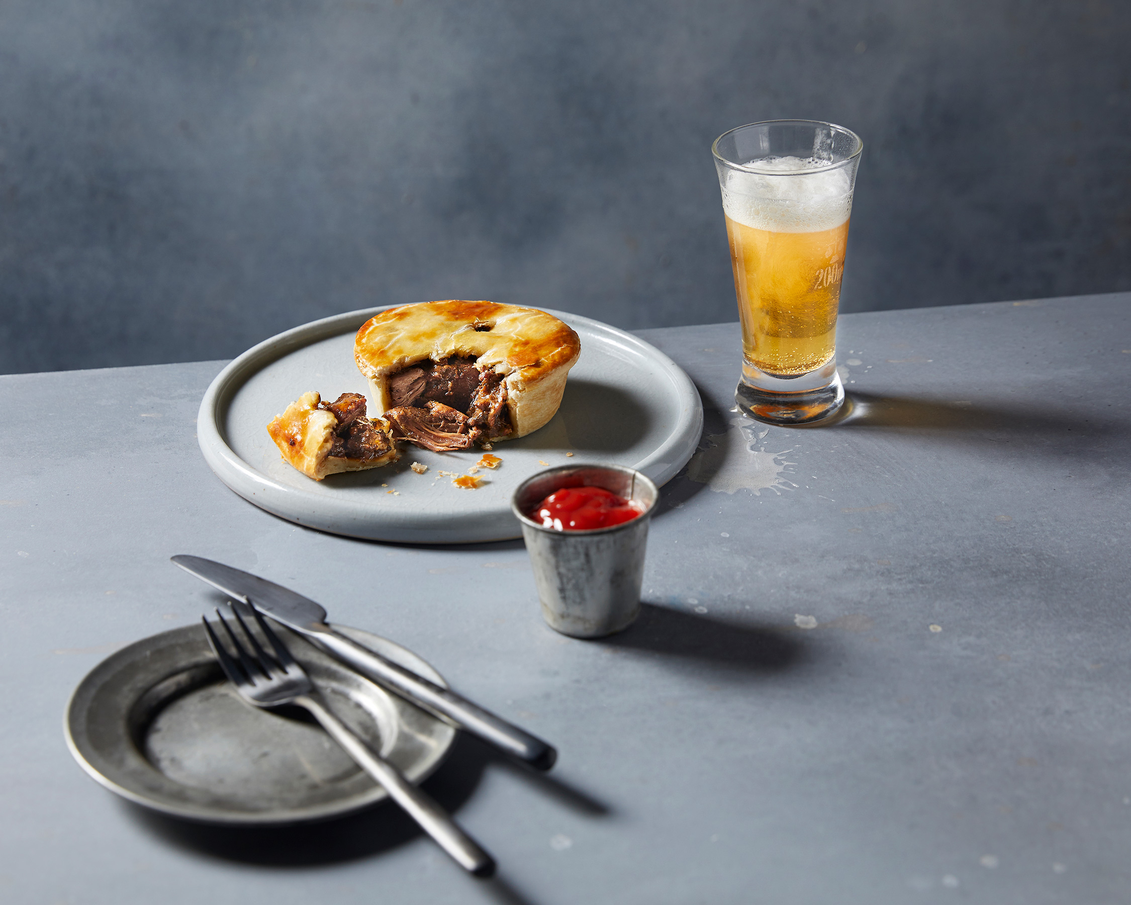 Beef and Red Wine Pie with Beer in a Glass